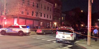 Police surround an apartment in Astoria where 4 people, including a child, were shot dead.