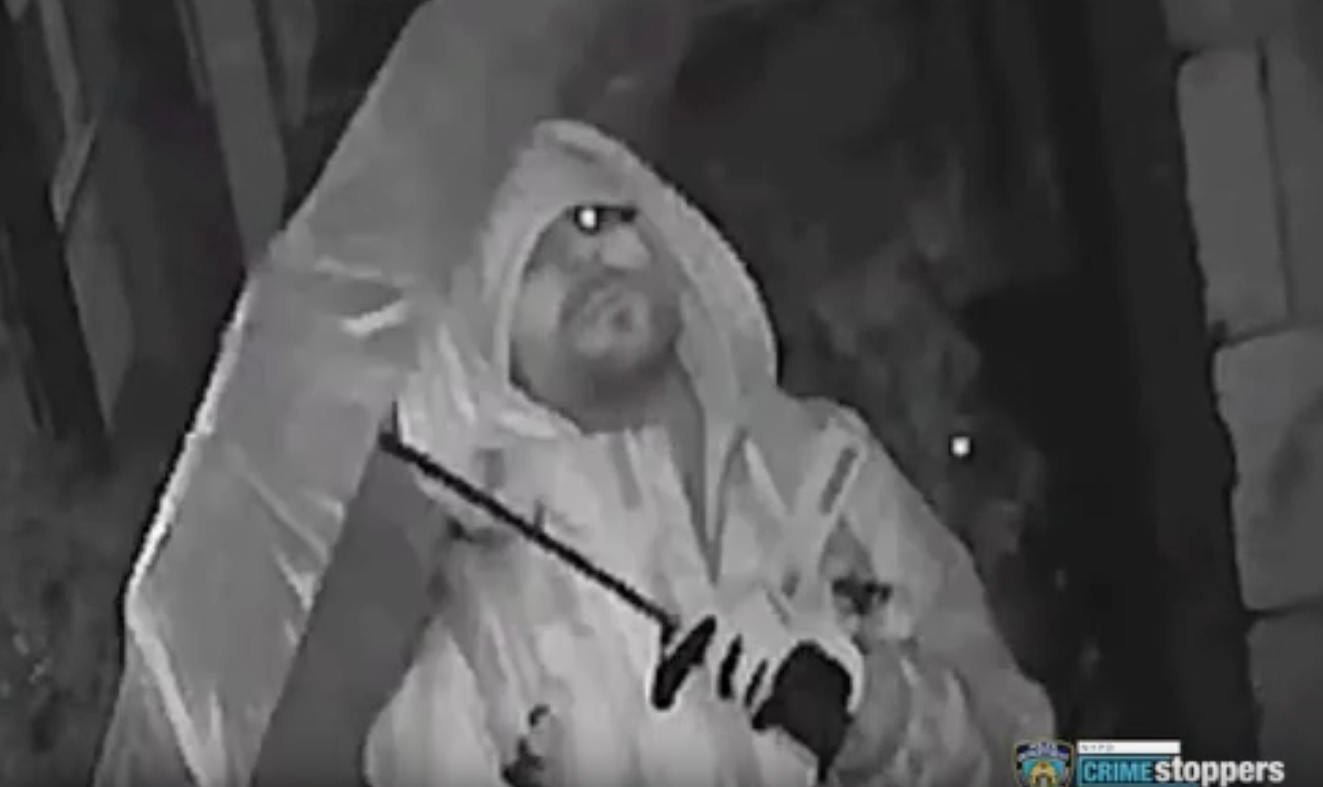 Image via NYPD 114th Precinct/NYPD Crime Stoppers surveillance video.