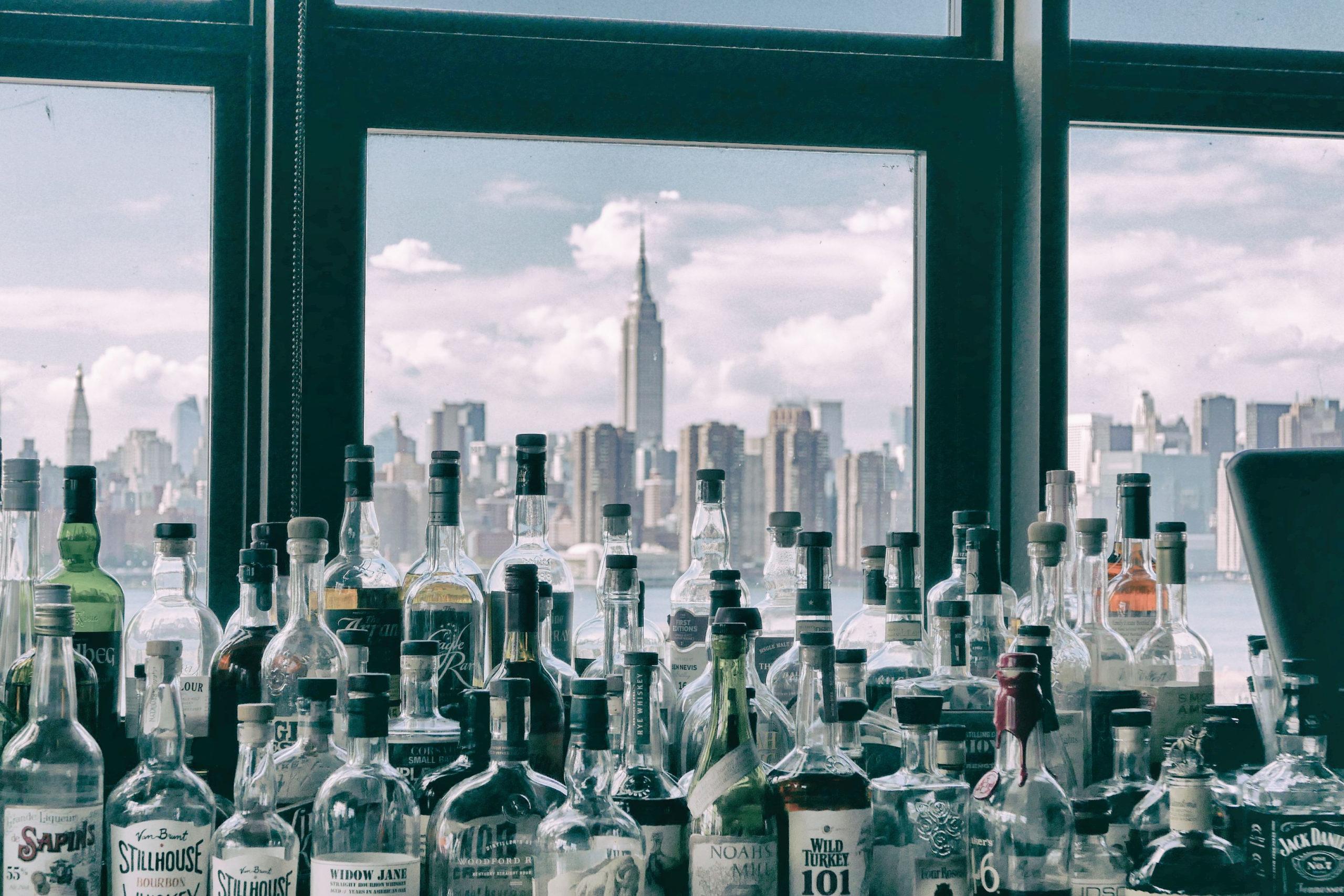 Canva - Assorted Bottles Near Windows