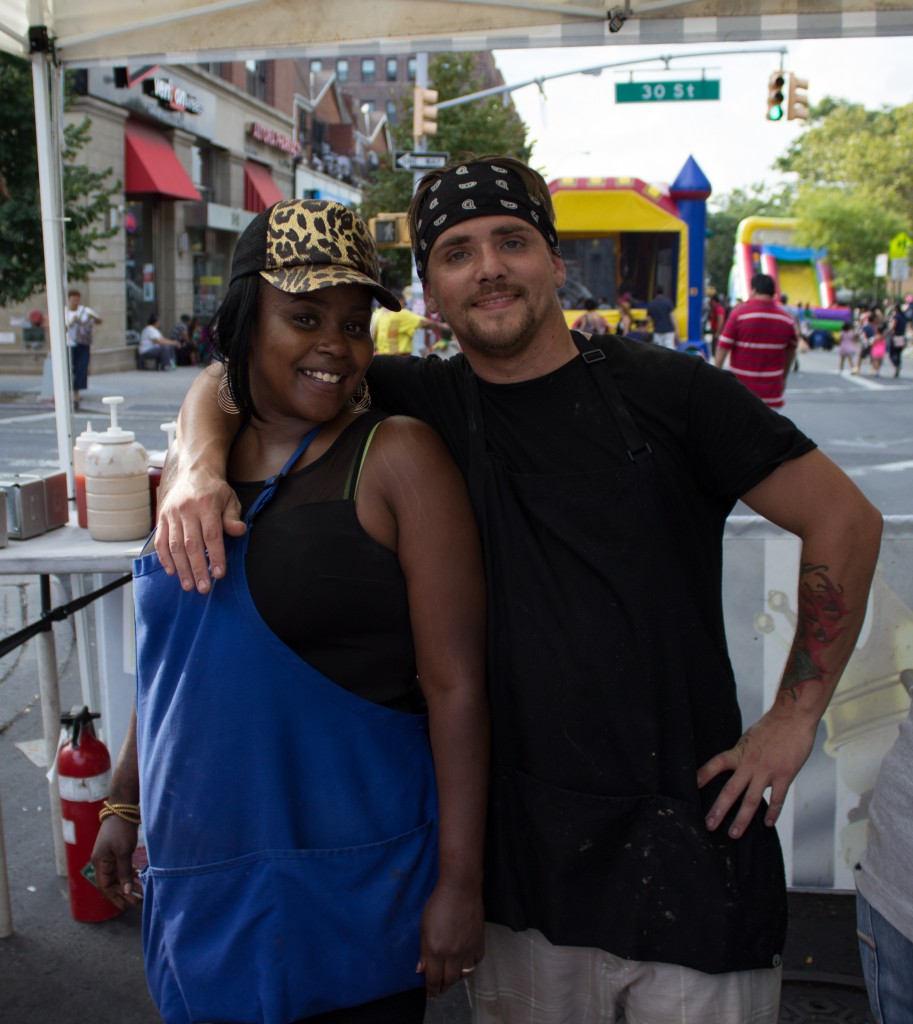 Nia and Adam at the Castle Burger booth.