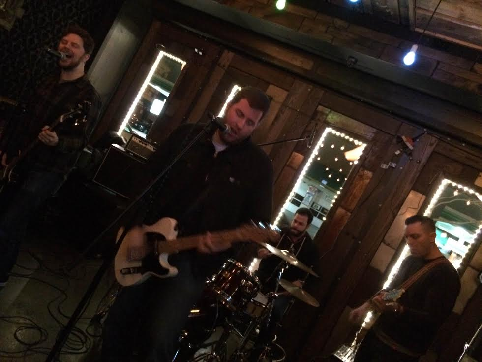 The Mess Around: Mark Wheeler, bass; Dave Harrison, vocals, guitar; Mike Rivera, drums; Nick Petropoulos, guitar.