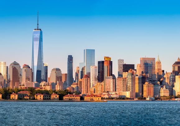 Downtown New York skyline panorama with Ellis Island in the foreground