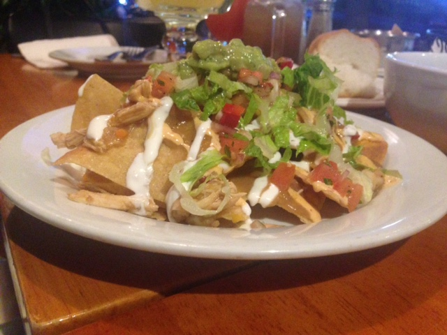 Caddy Wompous Nachos: Chicken, shrimp, pico de gallo, guacamole, cheddar cheese, lettuce, tomato, chipotle-aioli, sour cream (starter)
