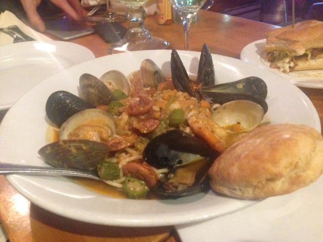 Seafood Gumbo: Linguini with shrimps, clams, calamari, mussels, Chorizo, roasted tomato, red wine and basil saffron